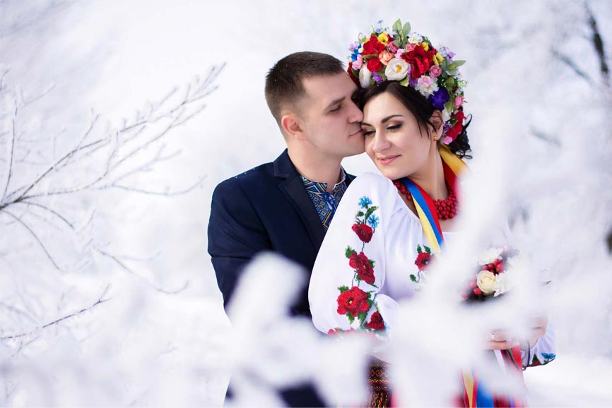 A man hugging one of the beautiful Ukraine women from behind.